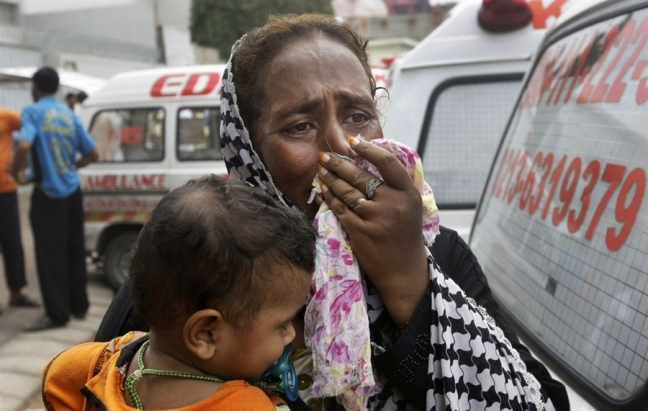 A woman mourns for a family member who was killed in the Karachi factory fire in September 2012. Photo from NBC News.
